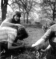 Jane Ostler, Fiona Thompson & ?, seem to be doing a spot of gardening.