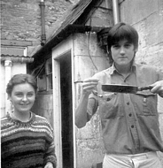 Hugh with frying pan, the girls name escapes me. Outside the kitchen at number 2.