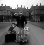 Roger & Hugh (in frog mask) in the driveway of Corsham court with a few props taken to the location.
